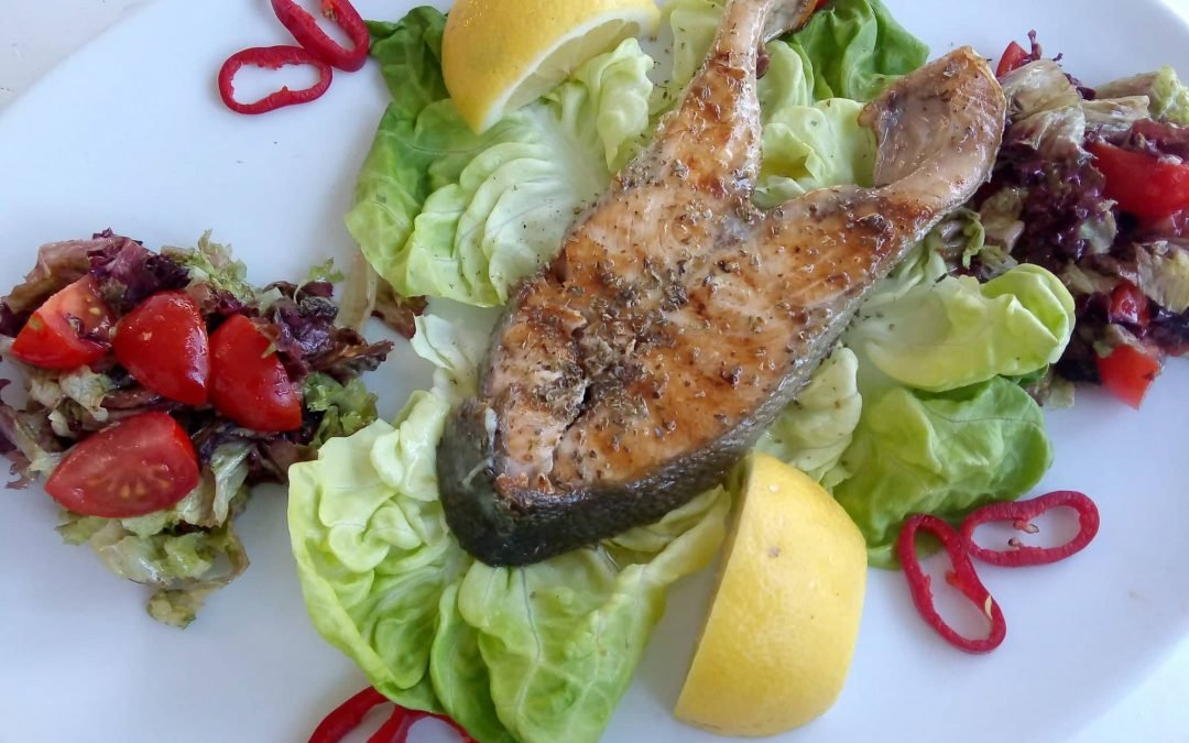 Fresh Salmon served with salad